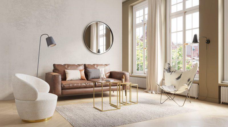 canapé en cuir marron zago dans salon design accompagné de fauteuils papillon et en laine bouclée=
